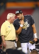 Jan 1, 2014; Glendale, AZ, USA; Central Florida Knights head coach George O'Leary (left) talks with quarterback Blake Bortles (5) after defeating the Baylor Bears during the Fiesta Bowl at University of Phoenix Stadium. Central Florida defeated Baylor 52-42. Mandatory Credit: Mark J. Rebilas-USA TODAY Sports