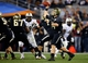 Jan 1, 2014; Glendale, AZ, USA; Baylor Bears quarterback Bryce Petty (14) throws a pass n the fourth quarter against the Central Florida Knights during the Fiesta Bowl at University of Phoenix Stadium. Central Florida defeated Baylor 52-42. Mandatory Credit: Mark J. Rebilas-USA TODAY Sports