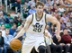 Jan 2, 2014; Salt Lake City, UT, USA; Utah Jazz shooting guard Gordon Hayward (20) drives during the second half against the Milwaukee Bucks at EnergySolutions Arena. The Jazz won 96-87. Mandatory Credit: Russ Isabella-USA TODAY Sports