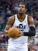 Jan 2, 2014; Salt Lake City, UT, USA; Utah Jazz power forward Derrick Favors (15) prepares to shoot a free throw during the second half against the Milwaukee Bucks at EnergySolutions Arena. The Jazz won 96-87. Mandatory Credit: Russ Isabella-USA TODAY Sports