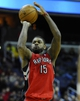 Jan 3, 2014; Washington, DC, USA; Toronto Raptors power forward Amir Johnson (15) attempts a shot against the Washington Wizards during the second half at Verizon Center. The Raptors defeated the Wizards 101 - 88. Mandatory Credit: Brad Mills-USA TODAY Sports