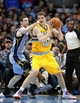 Jan 3, 2014; Denver, CO, USA; Memphis Grizzlies power forward Jon Leuer (30) guards Denver Nuggets center Timofey Mozgov (25) in the second quarter at the Pepsi Center. Mandatory Credit: Isaiah J. Downing-USA TODAY Sports