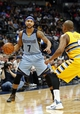 Jan 3, 2014; Denver, CO, USA; Denver Nuggets point guard Randy Foye (4) guards Memphis Grizzlies point guard Jerryd Bayless (7) in the second quarter at the Pepsi Center. Mandatory Credit: Isaiah J. Downing-USA TODAY Sports