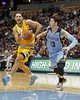 Jan 3, 2014; Denver, CO, USA; Denver Nuggets shooting guard Evan Fournier (94) drives to the net against Memphis Grizzlies small forward Mike Miller (13) in the third quarter at the Pepsi Center. The Nuggets won 111-108. Mandatory Credit: Isaiah J. Downing-USA TODAY Sports