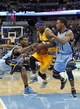 Jan 3, 2014; Denver, CO, USA; Memphis Grizzlies shooting guard Tony Allen (9) and point guard Mike Conley (11) guards Denver Nuggets point guard Ty Lawson (3) in the fourth quarter at the Pepsi Center. The Nuggets won 111-108. Mandatory Credit: Isaiah J. Downing-USA TODAY Sports