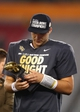Jan 1, 2014; Glendale, AZ, USA; Central Florida Knights quarterback Blake Bortles celebrates with the offensive MVP trophy after defeating the Baylor Bears during the Fiesta Bowl at University of Phoenix Stadium. Central Florida defeated Baylor 52-42. Mandatory Credit: Mark J. Rebilas-USA TODAY Sports