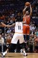 Jan 4, 2014; Phoenix, AZ, USA; Milwaukee Bucks forward Caron Butler (3) shoots the ball against Phoenix Suns forward Markieff Morris (11) in the first half at US Airways Center. Mandatory Credit: Jennifer Stewart-USA TODAY Sports