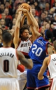 Jan. 04, 2014; Portland, OR, USA; Portland Trail Blazers center Robin Lopez (42) battles for a rebound with Philadelphia 76ers power forward Brandon Davies (20)  during the first quarter of the game at the Moda Center. Mandatory Credit: Steve Dykes-USA TODAY Sports