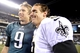 Jan 4, 2014; Philadelphia, PA, USA; New Orleans Saints quarterback Drew Brees (9) and Philadelphia Eagles quarterback Nick Foles (9) pose for a photo after the 2013 NFC wild card playoff football game at Lincoln Financial Field. The New Orleans Saints won the game 26-24. Mandatory Credit: Joe Camporeale-USA TODAY Sports