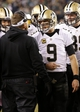 Jan 4, 2014; Philadelphia, PA, USA; New Orleans Saints quarterback Drew Brees (9) talks with Saints head coach Sean Payton (L) on the sidelines during a timeout against the Philadelphia Eagles in the fourth quarter during the 2013 NFC wild card playoff football game at Lincoln Financial Field. The Saints won 26-24. Mandatory Credit: Geoff Burke-USA TODAY Sports