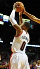 Jan. 04, 2014; Portland, OR, USA; Portland Trail Blazers point guard Damian Lillard (0) has his shot blocked during the fourth quarter of the game against the Philadelphia 76ers at the Moda Center. The Sixers won the game 101-99. Mandatory Credit: Steve Dykes-USA TODAY Sports