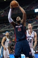 Jan 5, 2014; Auburn Hills, MI, USA; Detroit Pistons power forward Greg Monroe (10) shoots the ball during the second quarter against the Memphis Grizzlies at The Palace of Auburn Hills. Mandatory Credit: Tim Fuller-USA TODAY Sports