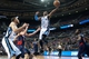 Jan 5, 2014; Auburn Hills, MI, USA; Memphis Grizzlies point guard Mike Conley (11) shoots the ball against the Detroit Pistons during the third quarter at The Palace of Auburn Hills. The Grizzlies won 112-84. Mandatory Credit: Tim Fuller-USA TODAY Sports