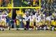 Jan 5, 2014; Green Bay, WI, USA; San Francisco 49ers kicker Phil Dawson (9) celebrates after making the game winning field goal during the fourth quarter against the Green Bay Packers during the 2013 NFC wild card playoff football game at Lambeau Field.  San Francisco won 23-20.  Mandatory Credit: Jeff Hanisch-USA TODAY Sports