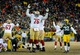 Jan 5, 2014; Green Bay, WI, USA;  The San Francisco 49ers tackle Anthony Davis (76) celebrates after beating the Green Bay Packer 23-20 on a field goal by kicker Phil Dawson (9)during the 2013 NFC wild card playoff football game at Lambeau Field. Mandatory Credit: Benny Sieu-USA TODAY Sports