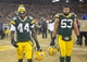 Jan 5, 2014; Green Bay, WI, USA;   Green Bay Packers running back James Starks (44) and linebacker Nick Perry (53) walks off the field after the San Francisco 49ers beat the Green Bay Packers 23-20 during the 2013 NFC wild card playoff football game at Lambeau Field. Mandatory Credit: Benny Sieu-USA TODAY Sports