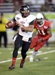 Jan 5, 2014; Mobile, AL, USA;  Arkansas State Red Wolves quarterback Fredi Knighten (9) rolls out of the pocket against the Ball State Cardinals during the fourth quarter at Ladd-Peebles Stadium. Mandatory Credit: John David Mercer-USA TODAY Sports