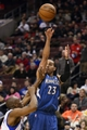 Jan 6, 2014; Philadelphia, PA, USA; Minnesota Timberwolves guard Kevin Martin (23) shoots a jump shot over the defense of Philadelphia 76ers guard James Anderson (9) during the third quarter at the Wells Fargo Center. The Timberwolves defeated the Sixers 126-95. Mandatory Credit: Howard Smith-USA TODAY Sports