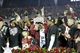 Jan 6, 2014; Pasadena, CA, USA; Florida State Seminoles head coach Jimbo Fisher and his players including Jameis Winston (left) celebrate with the Coaches Trophy after the 2014 BCS National Championship game against the Auburn Tigers at the Rose Bowl.  Mandatory Credit: Kirby Lee-USA TODAY Sports