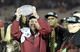Jan 6, 2014; Pasadena, CA, USA; Florida State Seminoles head coach Jimbo Fisher holds the Coaches Trophy after the 2014 BCS National Championship game against the Auburn Tigers at the Rose Bowl.  Mandatory Credit: Kirby Lee-USA TODAY Sports