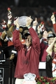 Jan 6, 2014; Pasadena, CA, USA; Florida State Seminoles head coach Jimbo Fisher (middle) celebrates with the Coaches Trophy after the 2014 BCS National Championship game against the Auburn Tigers at the Rose Bowl.  Mandatory Credit: Kirby Lee-USA TODAY Sports