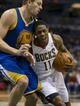 Jan 7, 2014; Milwaukee, WI, USA; Milwaukee Bucks guard Brandon Knight (11) dribbles the ball as Golden State Warriors forward David Lee (10) defends during the third quarter at BMO Harris Bradley Center. Mandatory Credit: Jeff Hanisch-USA TODAY Sports