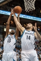 Jan 10, 2014; Minneapolis, MN, USA; Minnesota Timberwolves center Nikola Pekovic (14) and Minnesota Timberwolves small forward Corey Brewer (13) rebound in the first quarter against the Charlotte Bobcats at Target Center. Mandatory Credit: Brad Rempel-USA TODAY Sports