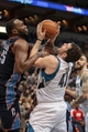 Jan 10, 2014; Minneapolis, MN, USA; Charlotte Bobcats center Al Jefferson (25) fouls Minnesota Timberwolves power forward Kevin Love (42) in the third quarter at Target Center. Minnesota wins 119-92. Mandatory Credit: Brad Rempel-USA TODAY Sports