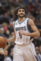 Jan 10, 2014; Minneapolis, MN, USA; Minnesota Timberwolves point guard Ricky Rubio (9) dribbles in the third quarter against the Charlotte Bobcats at Target Center. Minnesota wins 119-92. Mandatory Credit: Brad Rempel-USA TODAY Sports