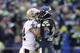 Jan 11, 2014; Seattle, WA, USA; New Orleans Saints wide receiver Kenny Stills (left) talks to Seattle Seahawks cornerback Richard Sherman (right) during the second half of the 2013 NFC divisional playoff football game at CenturyLink Field. Mandatory Credit: Joe Nicholson-USA TODAY Sports