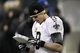 Jan 11, 2014; Seattle, WA, USA; New Orleans Saints quarterback Drew Brees (9) looks at a paper against the Seattle Seahawks during the second half of the 2013 NFC divisional playoff football game at CenturyLink Field. Mandatory Credit: Joe Nicholson-USA TODAY Sports