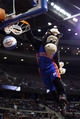 Jan 11, 2014; Auburn Hills, MI, USA; Detroit Pistons mascot Hooper dunks the ball during a time out against the Phoenix Suns at The Palace of Auburn Hills. Mandatory Credit: Rick Osentoski-USA TODAY Sports