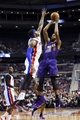 Jan 11, 2014; Auburn Hills, MI, USA; Phoenix Suns power forward Markieff Morris (11) shoots over Detroit Pistons small forward Josh Smith (6) in the first half at The Palace of Auburn Hills. Mandatory Credit: Rick Osentoski-USA TODAY Sports