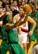 Jan 11, 2014; Portland, OR, USA; Boston Celtics small forward Gerald Wallace (45) grabs a rebound against the Portland Trail Blazers at the Moda Center. Mandatory Credit: Craig Mitchelldyer-USA TODAY Sports