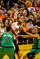 Jan 11, 2014; Portland, OR, USA; Portland Trail Blazers point guard Mo Williams (25) passes the ball away from Boston Celtics power forward Jared Sullinger (7) and small forward Jeff Green (8) at the Moda Center. Mandatory Credit: Craig Mitchelldyer-USA TODAY Sports