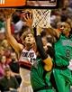 Jan 11, 2014; Portland, OR, USA; Portland Trail Blazers center Robin Lopez (42) shoots over Boston Celtics power forward Jared Sullinger (7) at the Moda Center. Mandatory Credit: Craig Mitchelldyer-USA TODAY Sports