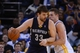 November 20, 2013; Oakland, CA, USA; Memphis Grizzlies center Marc Gasol (33) dribbles the basketball against Golden State Warriors power forward David Lee (10) during overtime at Oracle Arena. The Grizzlies defeated the Warriors 88-81 in overtime. Mandatory Credit: Kyle Terada-USA TODAY Sports
