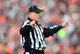 Dec 29, 2013; Cincinnati, OH, USA; NFL referee Larry Rose (128) during an NFL game between the Baltimore Ravens and Cincinnati Bengals at Paul Brown Stadium. Bengals defeated the Ravens 34-17. Mandatory Credit: Andrew Weber-USA TODAY Sports