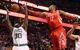 Jan 13, 2014; Boston, MA, USA; Houston Rockets power forward Dwight Howard (12) reaches for a rebound over Boston Celtics power forward Brandon Bass (30) during the first quarter at TD Garden. Mandatory Credit: Winslow Townson-USA TODAY Sports