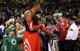 Jan 13, 2014; Boston, MA, USA; Houston Rockets power forward Dwight Howard (12) hands his game jersey to a fan wearing his number twelve after their 104-92 win over the Boston Celtics at TD Garden. Mandatory Credit: Winslow Townson-USA TODAY Sports