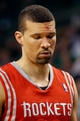 Jan 13, 2014; Boston, MA, USA; Houston Rockets shooting guard Francisco Garcia (32) leaves the game because of a cut on his forehead during the second half of Houston's 104-92 win over the Boston Celtics at TD Garden. Mandatory Credit: Winslow Townson-USA TODAY Sports
