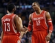 Jan 13, 2014; Boston, MA, USA; Houston Rockets power forward Dwight Howard (12) talks with shooting guard James Harden (13) during the second half of Houston's 104-92 win over the Boston Celtics at TD Garden. Mandatory Credit: Winslow Townson-USA TODAY Sports