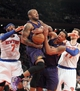 Jan 13, 2014; New York, NY, USA; Phoenix Suns small forward P.J. Tucker (17) grabs a rebound in front of New York Knicks small forward Carmelo Anthony (7) and New York Knicks power forward Andrea Bargnani (77) and Phoenix Suns power forward Channing Frye (8) during the third quarter of a game at Madison Square Garden. The Knicks defeated the Suns 98-96 in overtime. Mandatory Credit: Brad Penner-USA TODAY Sports