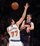 Jan 13, 2014; New York, NY, USA; Phoenix Suns shooting guard Goran Dragic (1) passes the ball while defended by New York Knicks power forward Andrea Bargnani (77) during the third quarter of a game at Madison Square Garden. The Knicks defeated the Suns 98-96 in overtime. Mandatory Credit: Brad Penner-USA TODAY Sports