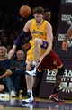 Jan 14, 2014; Los Angeles, CA, USA; Los Angeles Lakers center Pau Gasol (16) reacts after he gets his foot stepped on by Cleveland Cavaliers small forward Luol Deng (9) in the first half of the game at Staples Center. Mandatory Credit: Jayne Kamin-Oncea-USA TODAY Sports