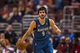 Jan 6, 2014; Philadelphia, PA, USA; Minnesota Timberwolves guard Ricky Rubio (9) brings the ball up court during the third quarter against the Philadelphia 76ers at the Wells Fargo Center. The Timberwolves defeated the Sixers 126-95. Mandatory Credit: Howard Smith-USA TODAY Sports