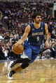 Jan 6, 2014; Philadelphia, PA, USA; Minnesota Timberwolves guard Ricky Rubio (9) dribbles the ball during the third quarter against the Philadelphia 76ers at the Wells Fargo Center. The Timberwolves defeated the Sixers 126-95. Mandatory Credit: Howard Smith-USA TODAY Sports