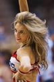 Jan 15, 2014; Philadelphia, PA, USA; A Philadelphia 76ers dream team dancer performs during the fourth quarter against the Charlotte Bobcats at the Wells Fargo Center. The Sixers defeated the Bobcats 95-92. Mandatory Credit: Howard Smith-USA TODAY Sports