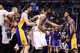Jan 15, 2014; Phoenix, AZ, USA; Los Angeles Lakers forward Nick Young (right) yells as Phoenix Suns center Alex Len (left)  is held back by NBA officials.  Phoenix Suns forward Marcus Morris (15) and forward Markieff Morris (11) step in the middle in the first half at US Airways Center. Mandatory Credit: Jennifer Stewart-USA TODAY Sports