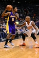 Jan 15, 2014; Phoenix, AZ, USA; Los Angeles Lakers forward Nick Young (0) handles the against Phoenix Suns forward P.J. Tucker (17) in the first half at US Airways Center. The Suns won 121-114. Mandatory Credit: Jennifer Stewart-USA TODAY Sports